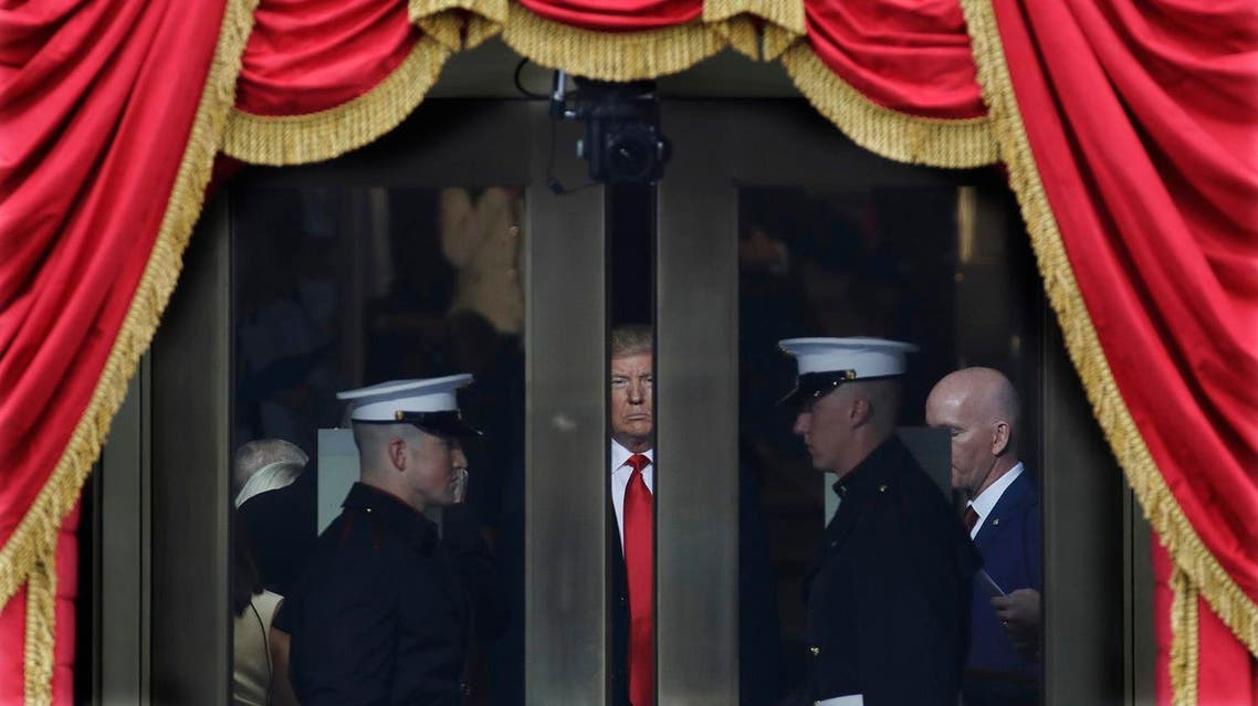 President-elect Donald Trump waits to step out onto the portico for his Presidential Inauguration at the US Capitol in Washington, Friday, Jan. 20, 2017. (Photo: AP/Patrick Semansky)