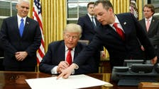 Donald Trump signs his first executive order