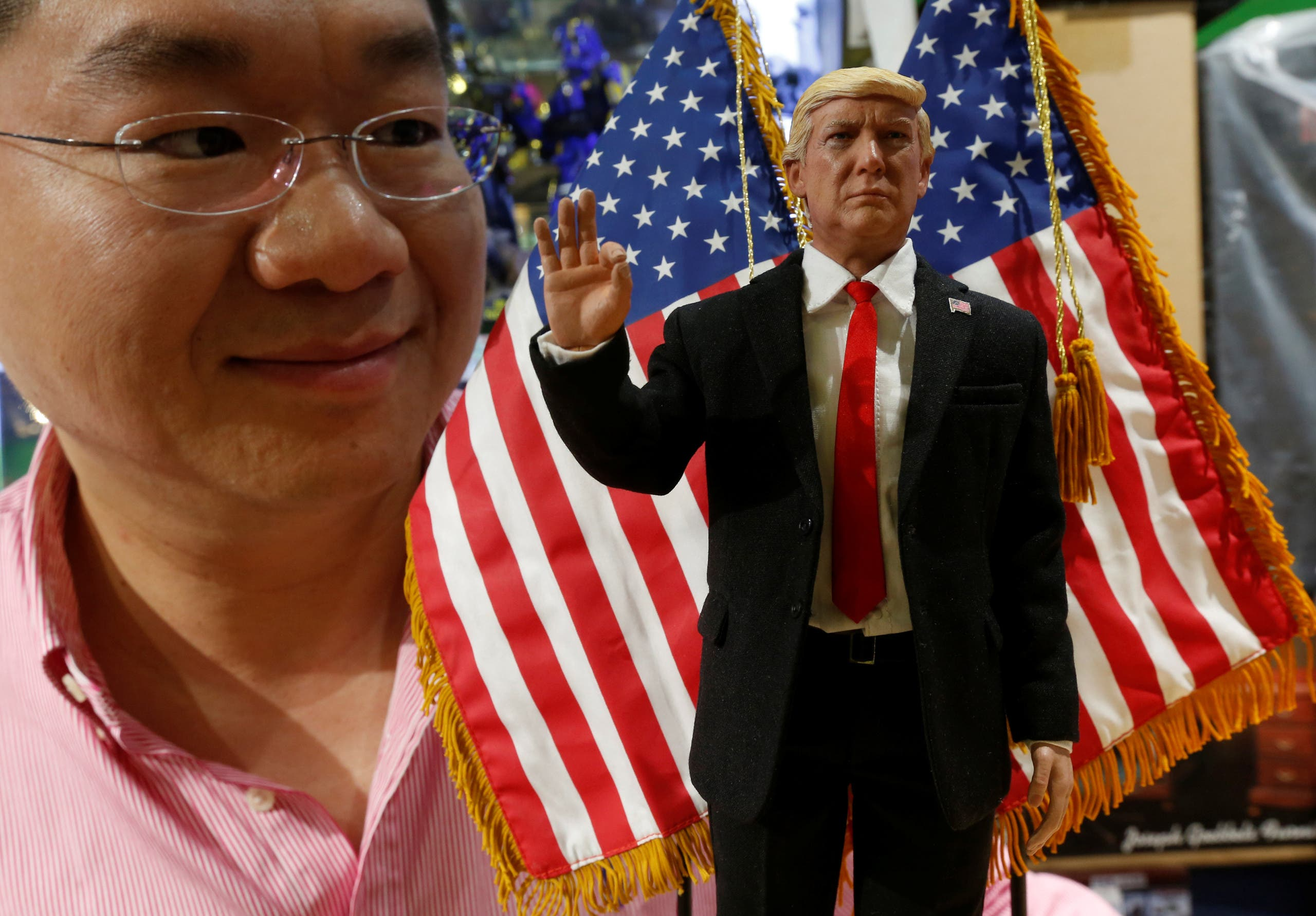 DID Corporation CEO Howard Cheung poses with a prototype 12-inch action figure of U.S. President Donald Trump, which will be available in March, in Hong Kong, China January 21, 2017. REUTERS/Bobby Yip TPX IMAGES OF THE DAY