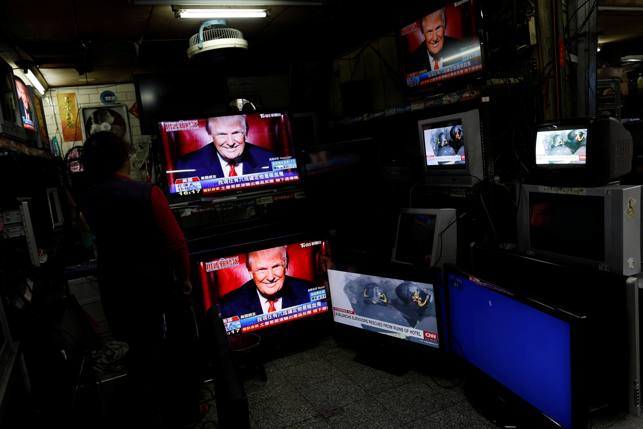 Images of U.S. President Donald Trump are seen on TV screens at a second hand shop in Taipei,Taiwan January 21, 2017. REUTERS/Tyrone Siu