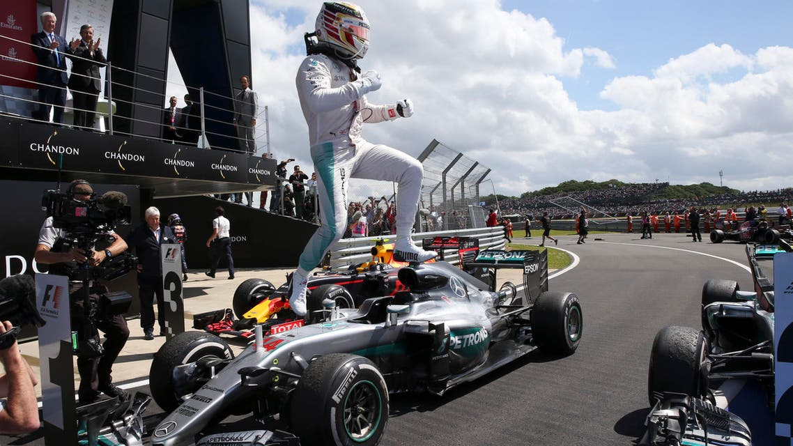 Mercedes driver Lewis Hamilton of Britain jumps from his car in celebration after winning the British Formula One Grand Prix at the Silverstone racetrack, Silverstone, England, Sunday, July 10, 2016. AP