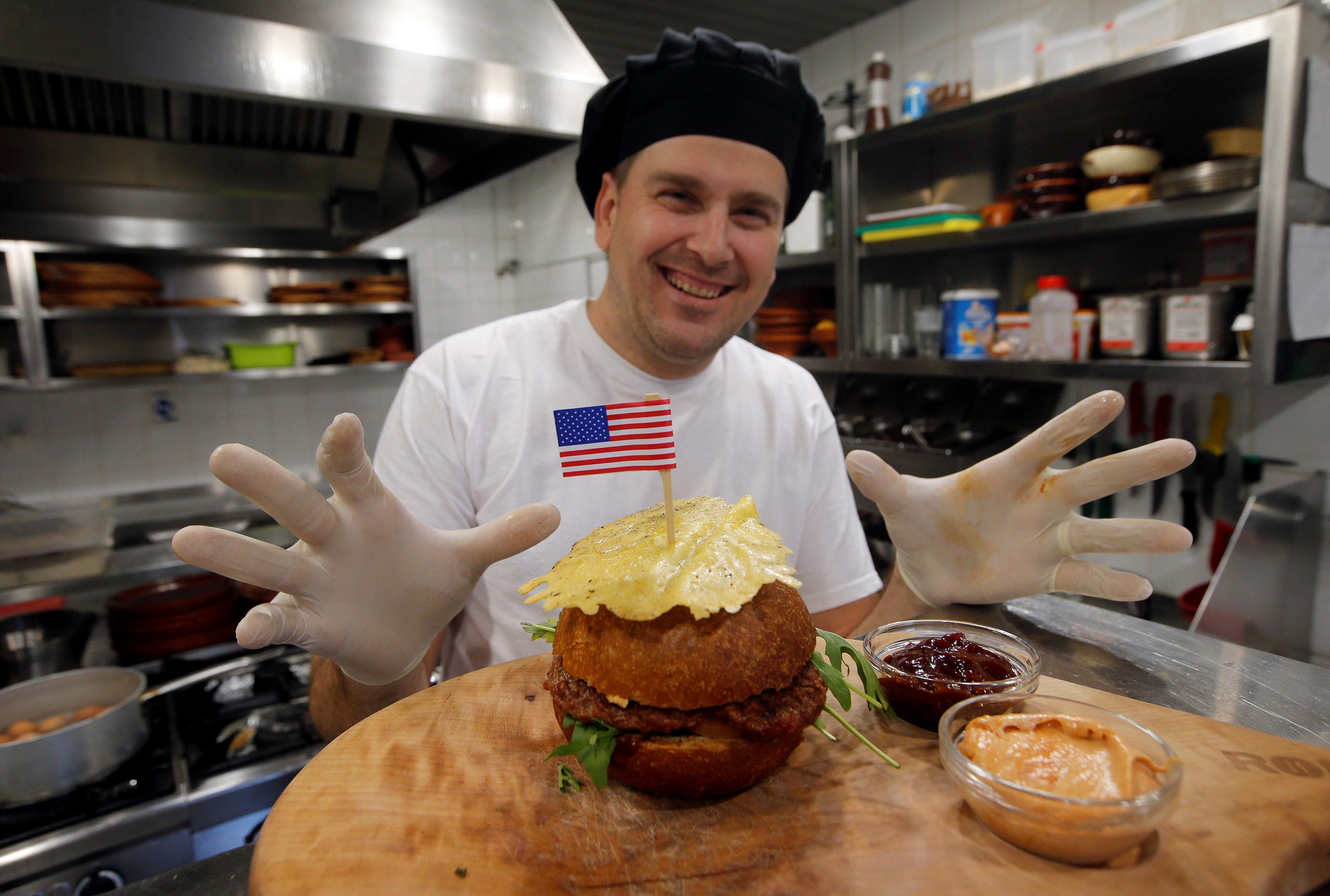 Chef Elvis Suhodoljac prepares a burger named President's burger in Melania  Trump's hometown of Sevnica, Slovenia January 20, 2017. (Reuters)