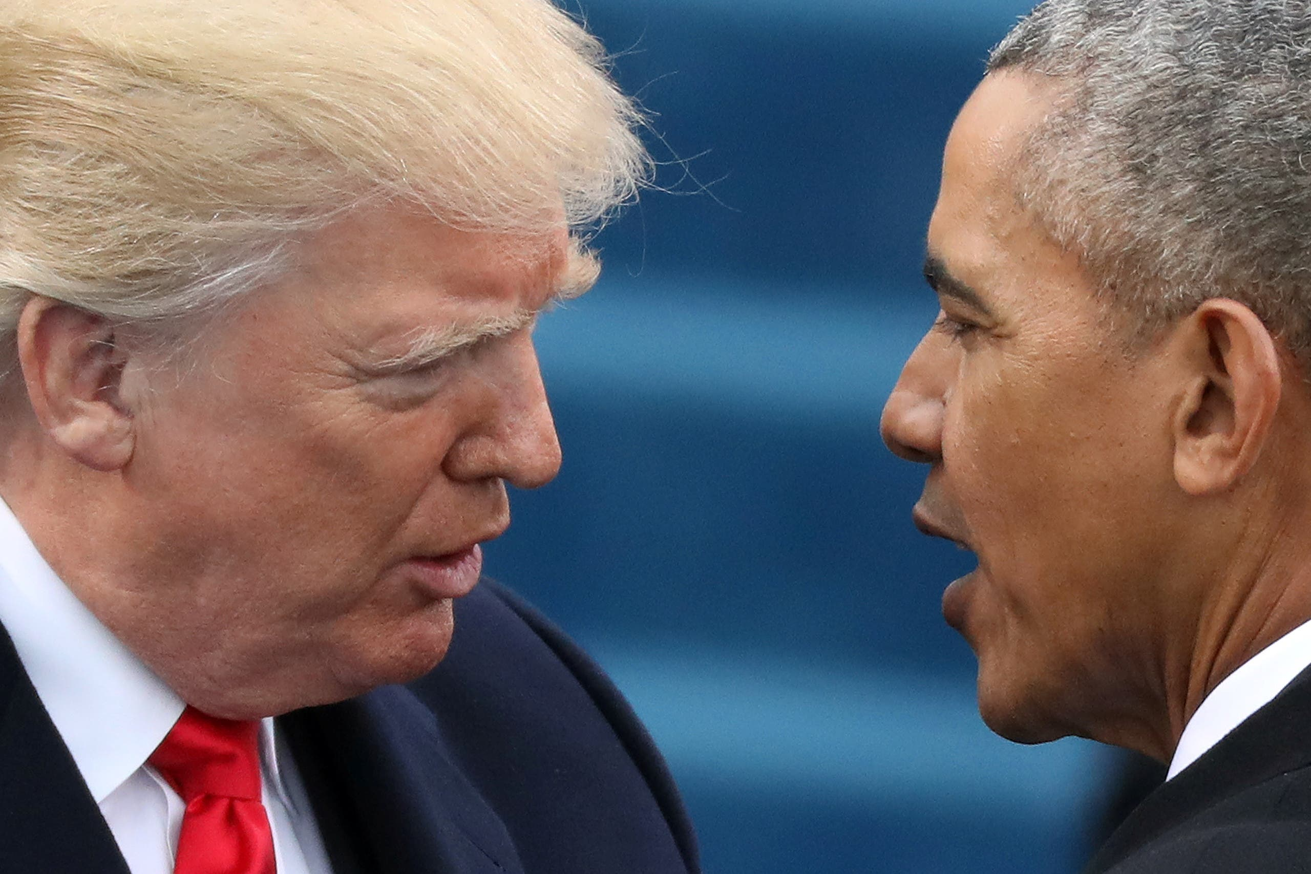 U.S. President Barack Obama (R) greets President-elect Donald Trump at inauguration ceremonies swearing in Trump as president on the West front of the U.S. Capitol in Washington, U.S., January 20, 2017. REUTERS/Carlos Barria