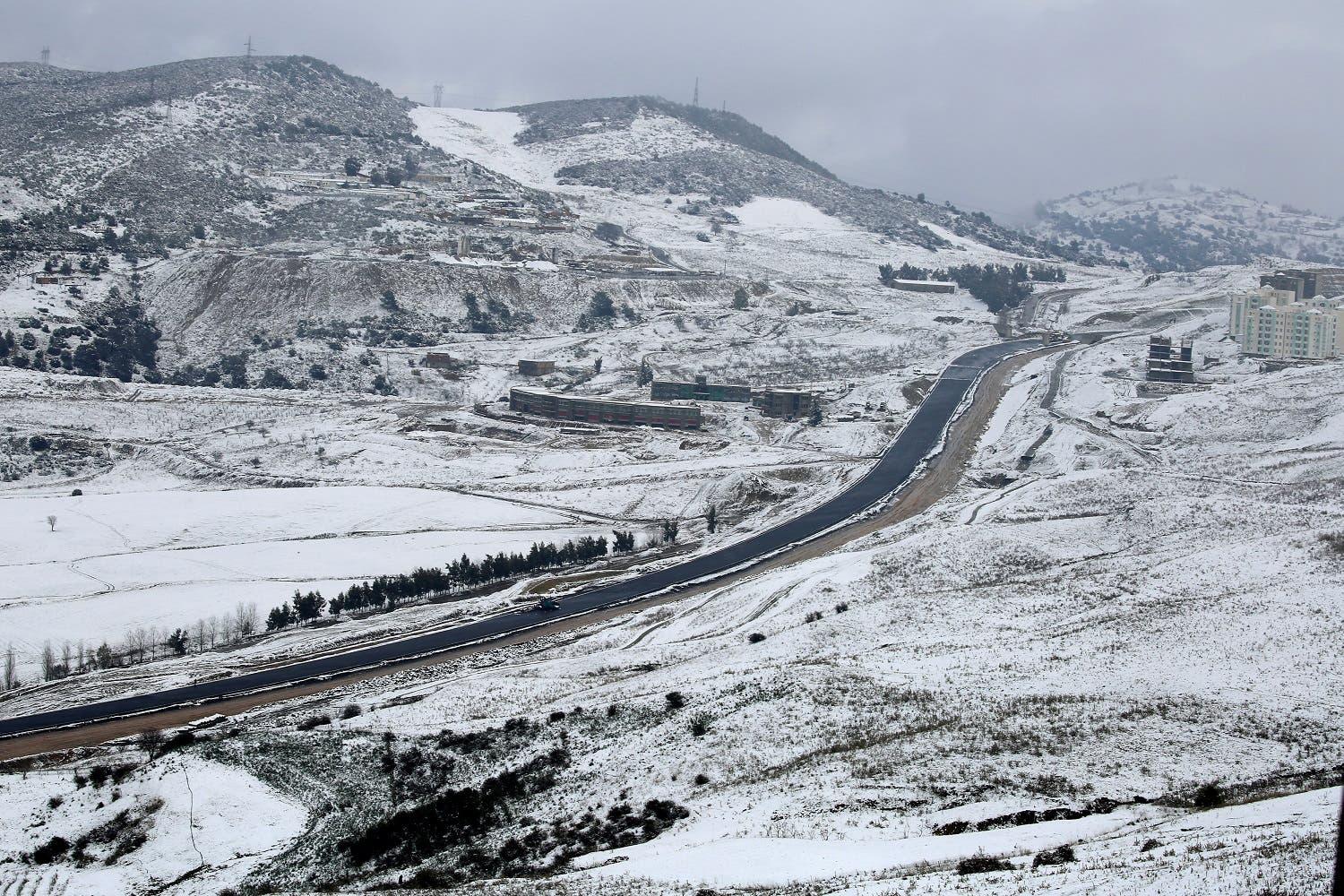 A general view shows a road after snowfall on the outskirts of Medea. (Reuters)
