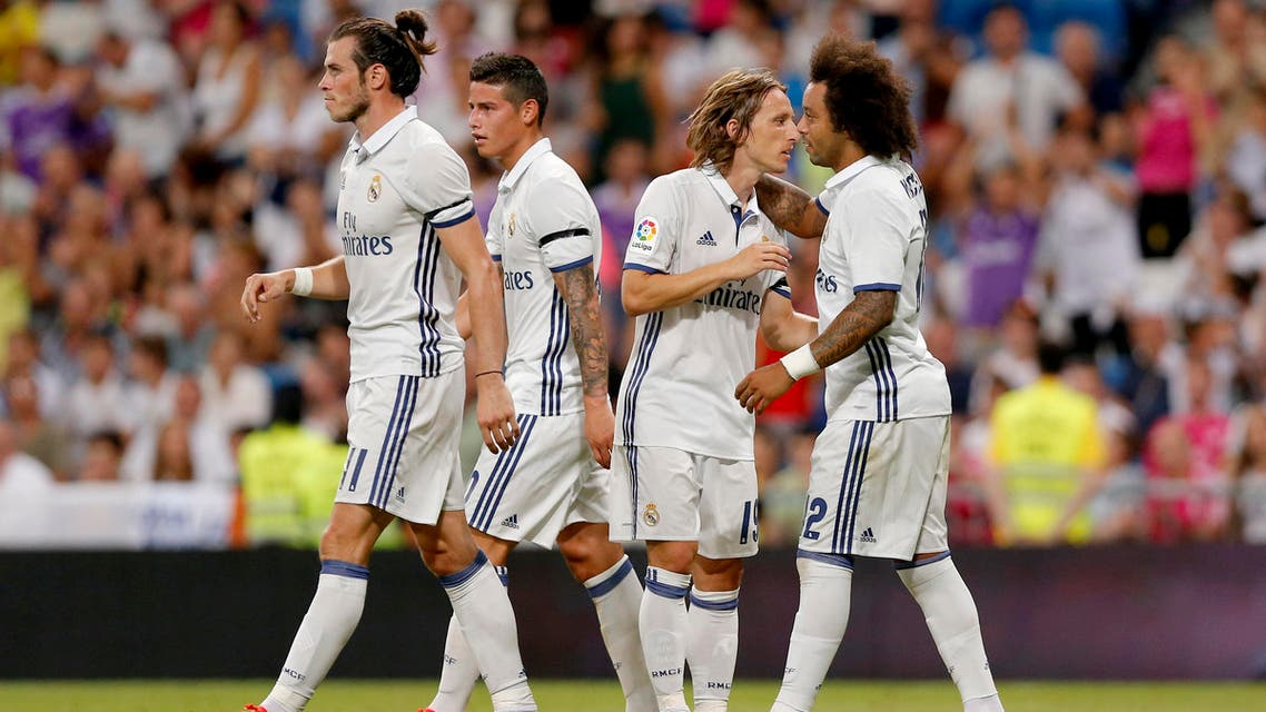Real Madrid Bale, James, Modric and Marcelo, celebrate their side third goal during a Santiago Bernabeu Trophy soccer match between Real Madrid and Stade de Reims at the Santiago Bernabeu stadium in Madrid, Spain, Tuesday, Aug. 16, 2016. (AP