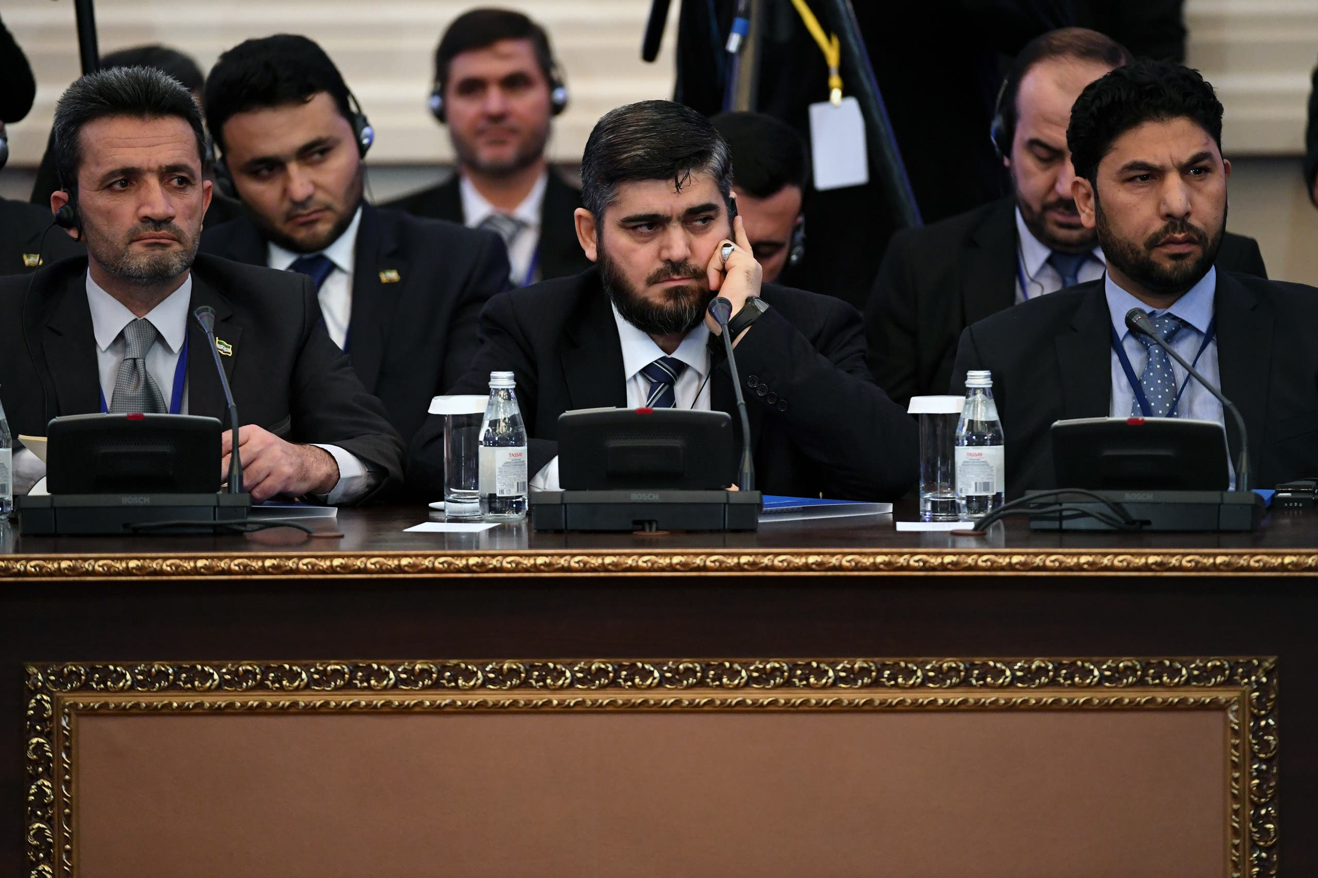 Chief opposition negotiator Mohammad Alloush (C) of the Jaish al-Islam (Army of Islam) rebel group attends the first session of Syria peace talks at Astana's Rixos President Hotel on January 23, 2017.  afp