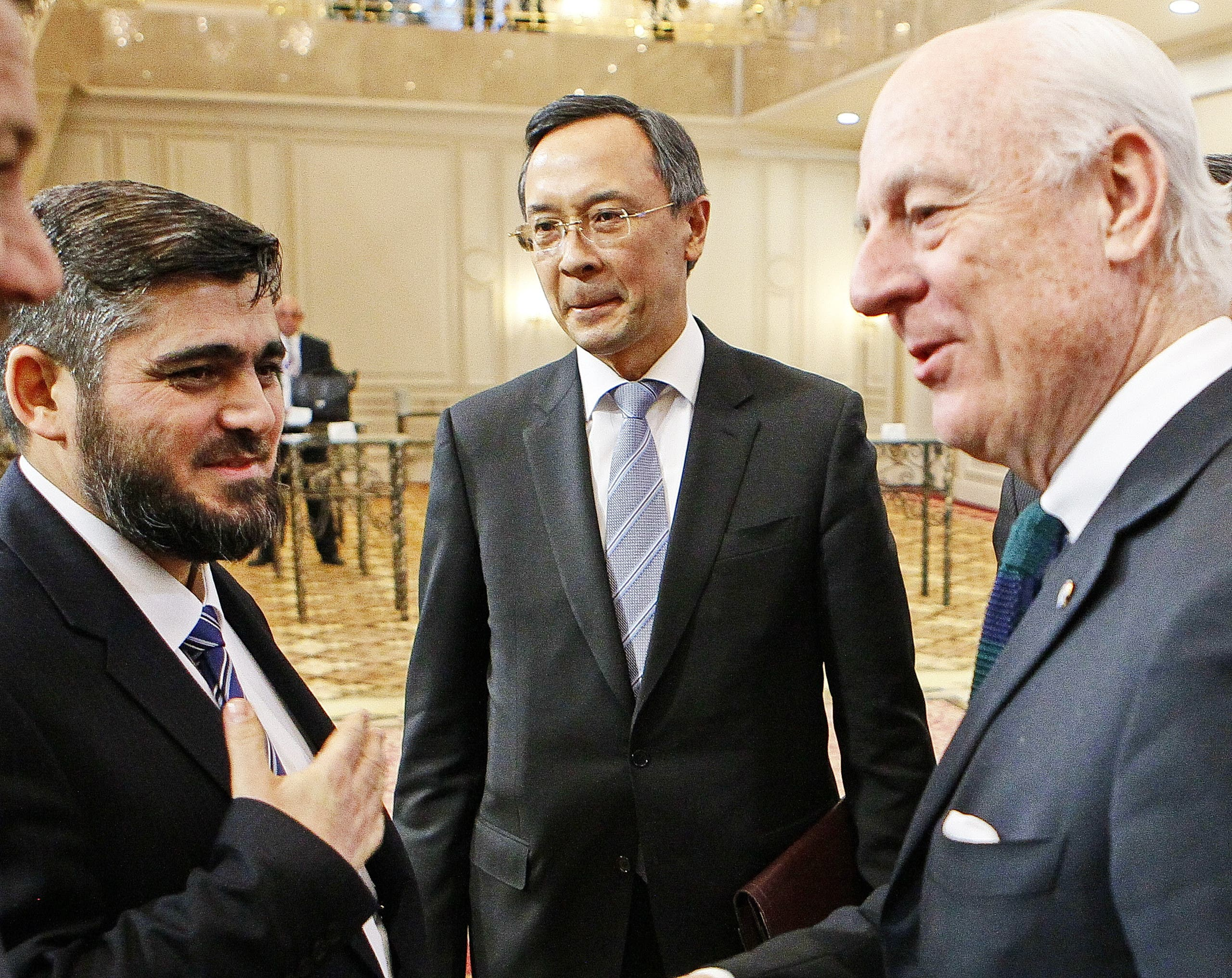 UN envoy for Syria Staffan de Mistura (R) speaks with chief opposition negotiator Mohammad Alloush (L) of the Jaish al-Islam (Army of Islam) rebel group as Kazakh Foreign Minister Kairat Abdrakhmanov stands beside prior to the first session of Syria peace talks at Astana's Rixos President Hotel on January 23, 2017.