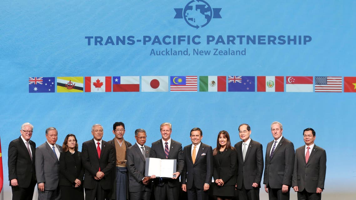 Trade delegates pose for a photograph after signing the Trans-Pacific Partnership Agreement in Auckland, New Zealand, Thursday, Feb. 4, 2016. AP