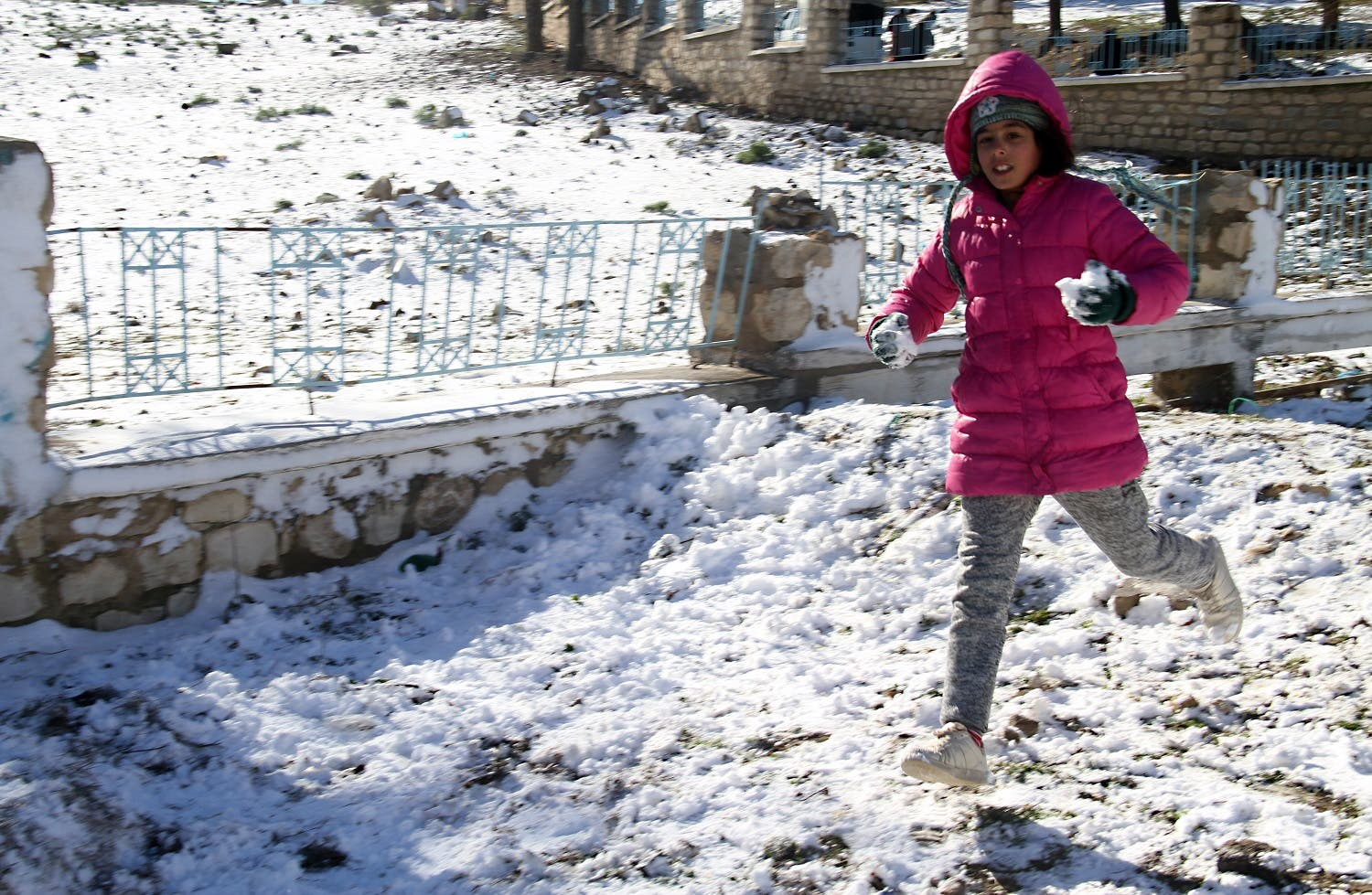 A Tunisian girl plays in the snow in the town of Maktar in Tunisia's central Siliana region on January 16, 2017. (AFP)