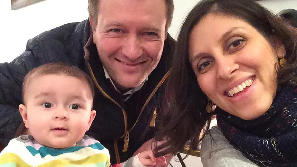 An undated handout image released by the Free Nazanin campaign in London on June 10, 2016 shows Nazanin Zaghari-Ratcliffe (R) posing for a photograph with her husband Richard and daughter Gabriella (L). Richard Ratcliffe told AFP that his wife, aged 37 and holds dual Iranian- British nationality (not recognized in Iran), was arrested on April 3 at Tehran airport as she was preparing to return to the UK with her daughter, then aged 22 months, after a visit to his family in Iran. AFP