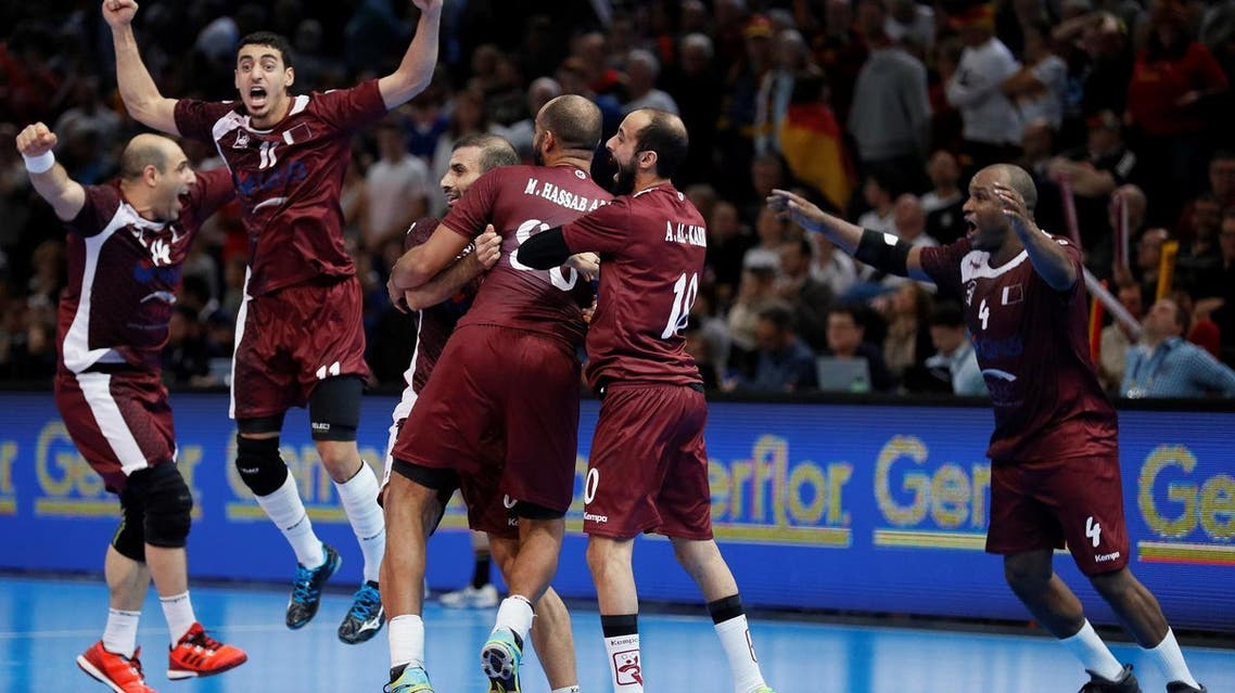 Qatar's pivot Bassel Alrayes (L), Qatar's left wing Murad Abdulrazzaq (2ndL), Qatar's left wing Hassan Mabrouk (R) and teammates celebrate after Qatar defeated Germany in the 25th IHF Men's World Championship 2017 eighth final handball match Germany vs Qatar on January 22, 2017 at the AccorHotels Arena in Paris.  THOMAS SAMSON / AFP