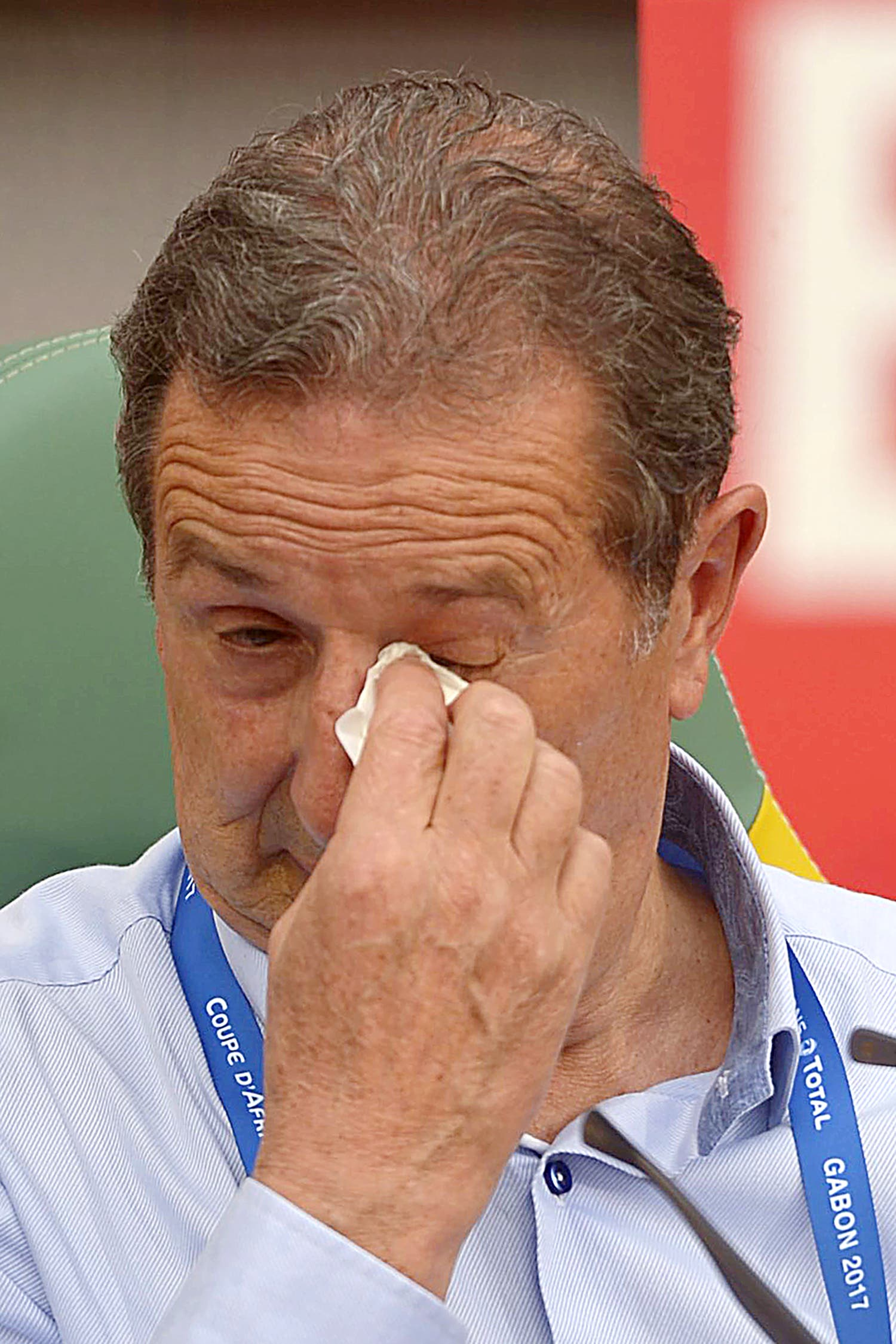 Algeria's Belgian coach Georges Leekens wipes his eye during the 2017 Africa Cup of Nations group B football match between Algeria and Tunisia in Franceville on January 19, 2017. (AFP)