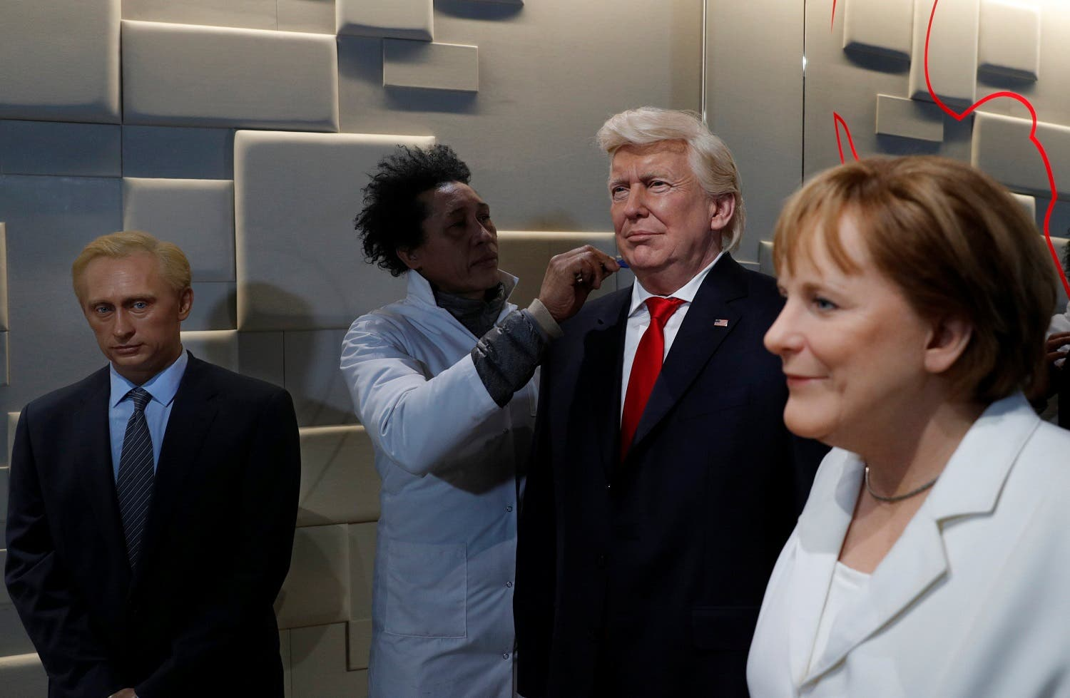 An assistant finishes the detail on a Donald Trump wax work dummy at a Paris museum (Photo: Reuters)