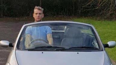 """محاكمة رجل """"طويل"""" قاد سيارة واقفاً.. والصورة هي الحكم"""