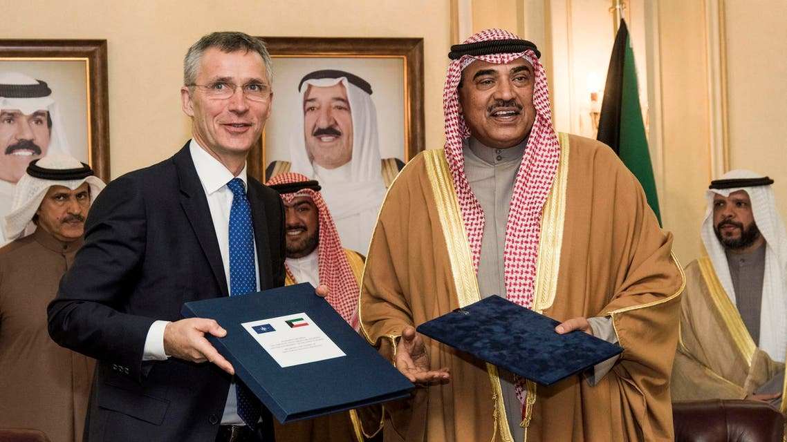 A handout picture released by the NATO Media Library on January 24, 2017 shows Kuwaiti First Deputy Prime Minister and Foreign Minister Sheikh Sabah al-Khaled al-Sabah (R) posing for a picture with NATO Secretary General Jens Stoltenberg following their meeting in Kuwait City.