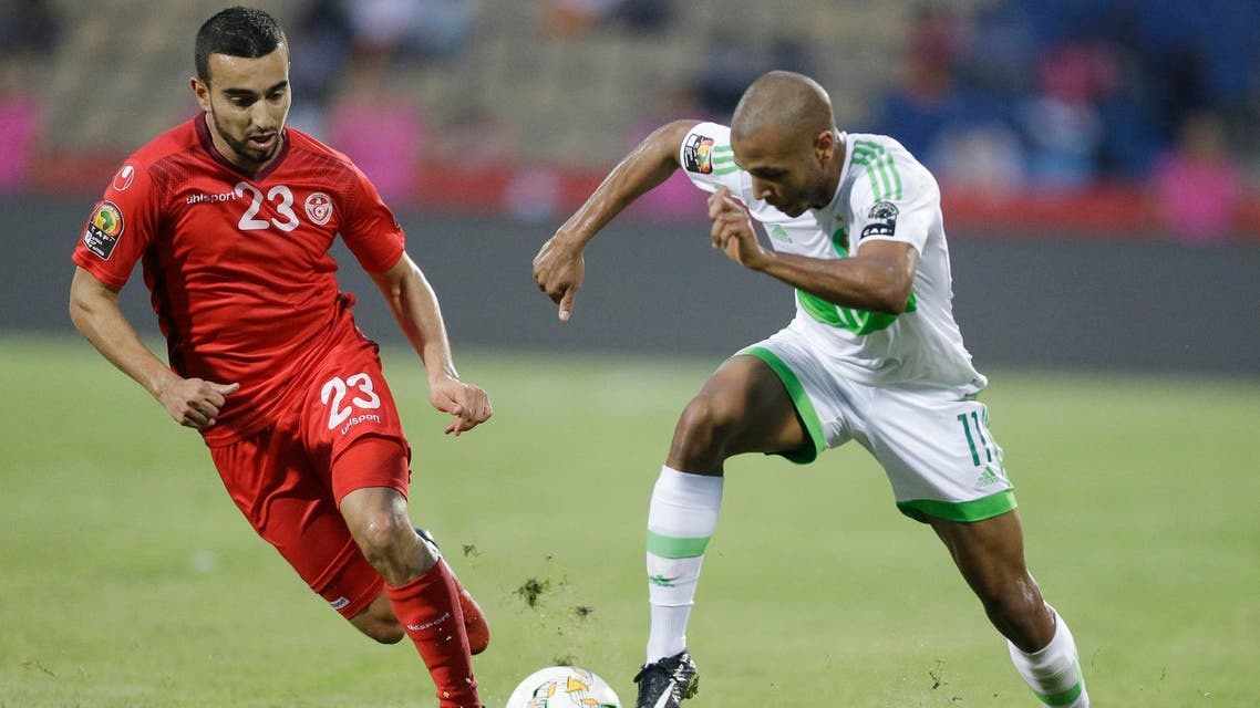 Algeria's Yacine Brahimi, right, in action with Tunisia's Sliti Naim, left, during the African Cup of Nations Group B soccer match between Algeria and Tunisia at Stade de Franceville Stadium, Gabon, Thursday Jan. 19, 2017. (AP)