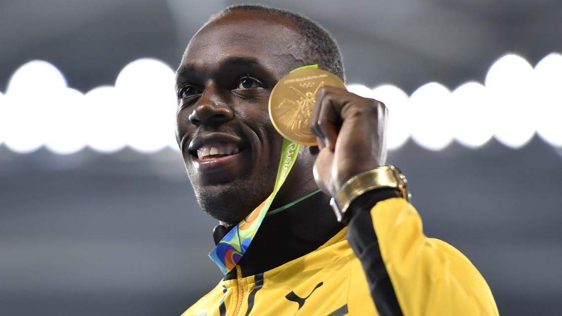 Jamaica's Usain Bolt poses with his gold medal during the podium ceremony for the Men's 200m during the athletics event at the Rio 2016 Olympic Games at the Olympic Stadium in Rio de Janeiro on August 19, 2016. (AFP)
