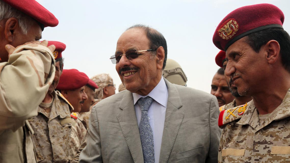 Yemeni Vice President General Ali Mohsen al-Ahmar (C) shakes hands with army officers as he visits military barracks in the eastern city of Marib on August 15, 2016. AFP