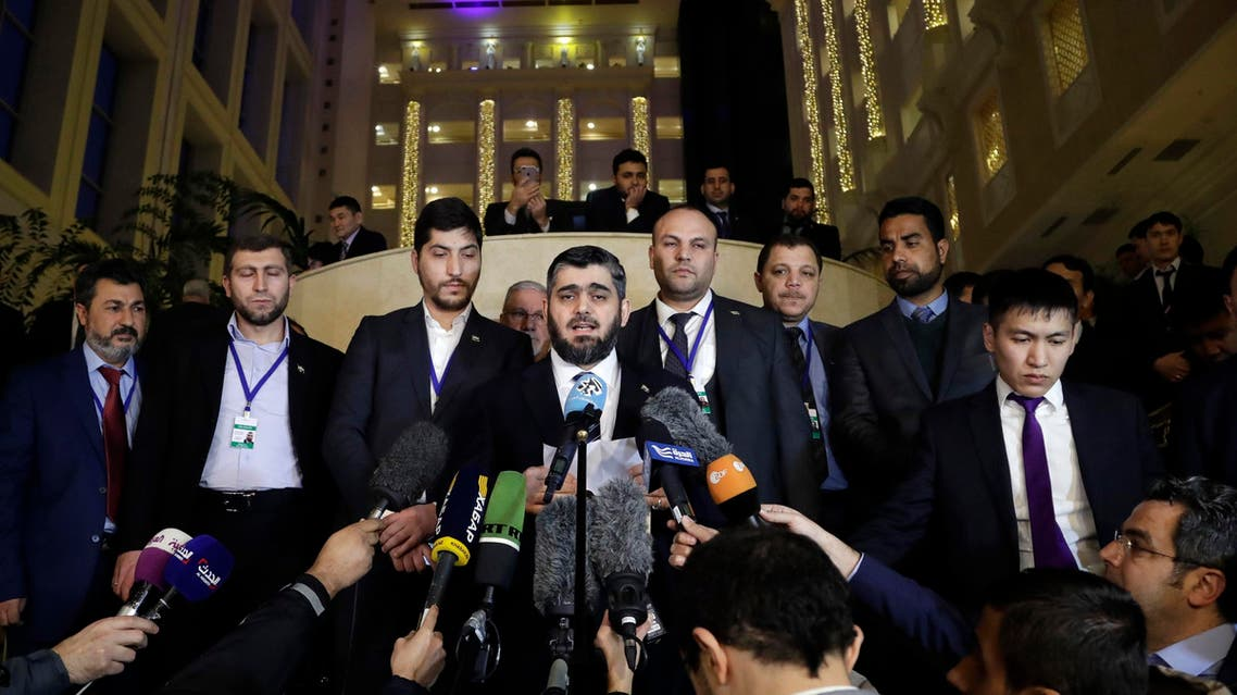 Mohammed Alloush, head of a Syrian opposition delegation, center, speaks to the media after the talks on Syrian peace in Astana, Kazakhstan, Tuesday, Jan. 24, 2017. Russia, Iran and Turkey _ sponsors of talks in Kazakhstan between Syria and rebel factions _ pledged Tuesday to consolidate the country's nearly month-old cease-fire and set up a three-way mechanism to ensure compliance of all sides. (AP)