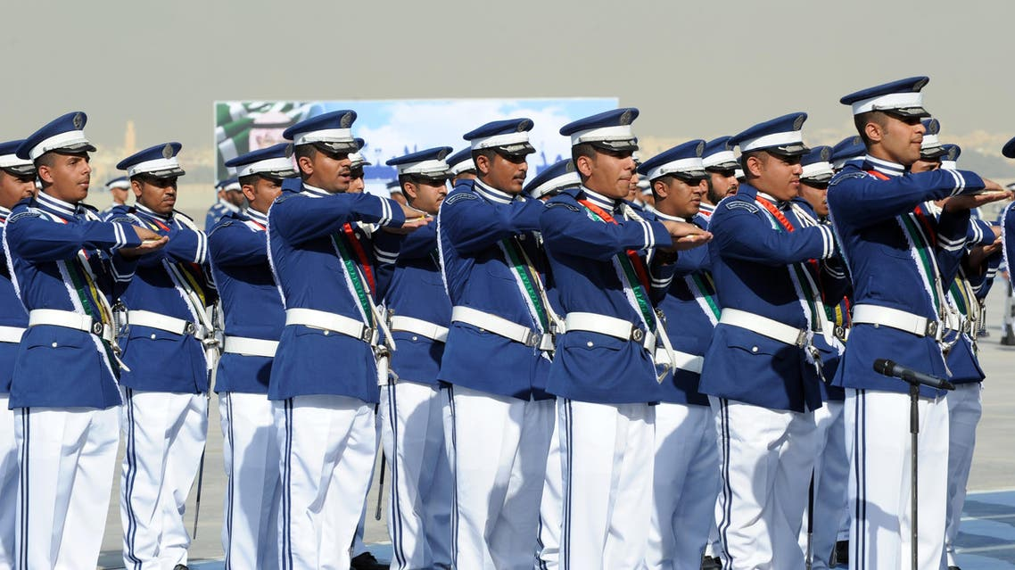 Saudi graduate air force officers performs the loyalty oath as they hold the Muslim Koran holy book during the graduation ceremony of the 83rd batch of King Faisal Air Academy