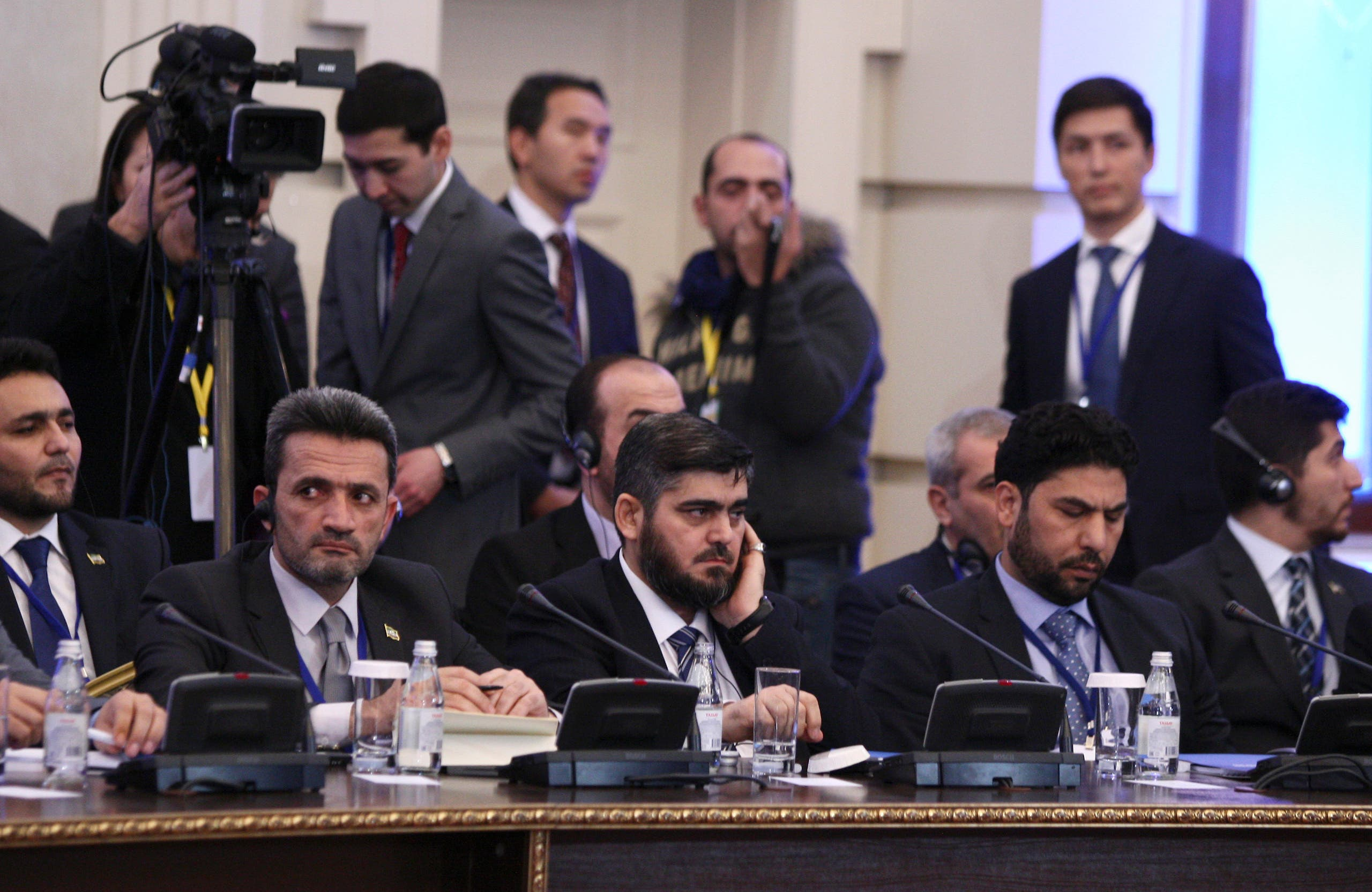 Mohammad Alloush (C), the head of the Syrian opposition delegation, attends Syria peace talks in Astana, Kazakhstan January 23, 2017. REUTERS/Mukhtar Kholdorbekov