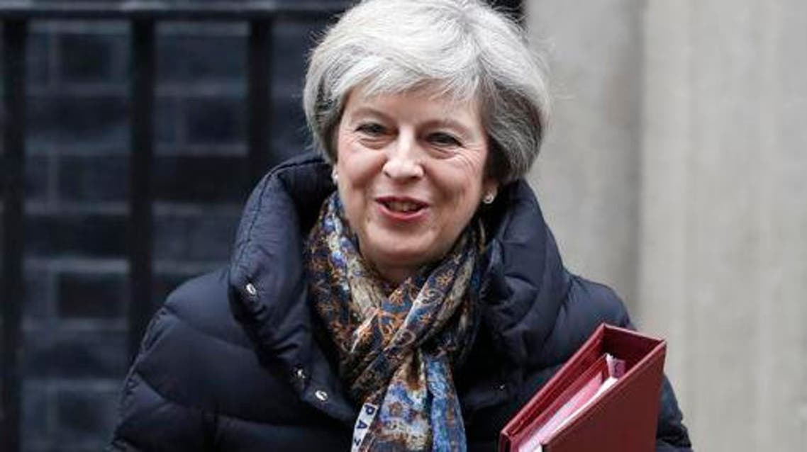 Britain's Prime Minister Theresa May leaves 10 Downing Street to attend parliament in London, Wednesday, Jan. 25, 2017. (AP)
