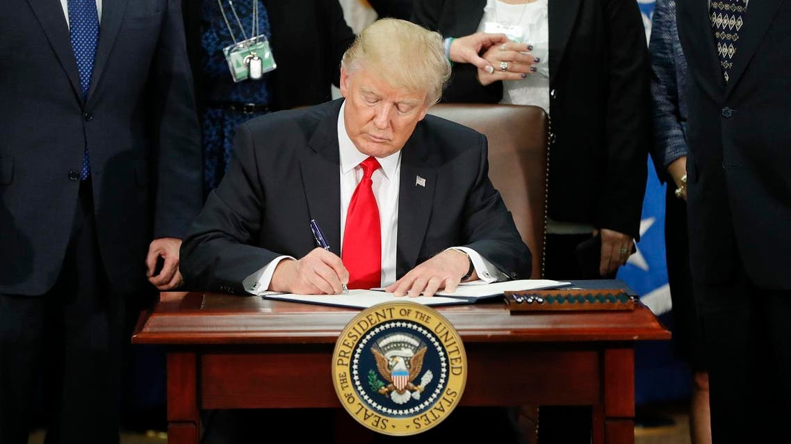 President Donald Trump signs an executive order for border security and immigration enforcement improvements, Wednesday, Jan. 25, 2017, at the Homeland Security Department in Washington. (AP)
