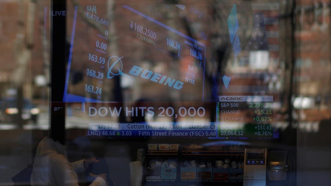 News of the Dow Jones Industrial average passing 20,000 and Boeing's stock price play on television at a Fidelity Investments office in Cambridge, Massachusetts, US, on January 25, 2017. (Reuters)