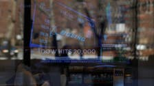 Dow Jones industrial average breaks through 20,000 milestone