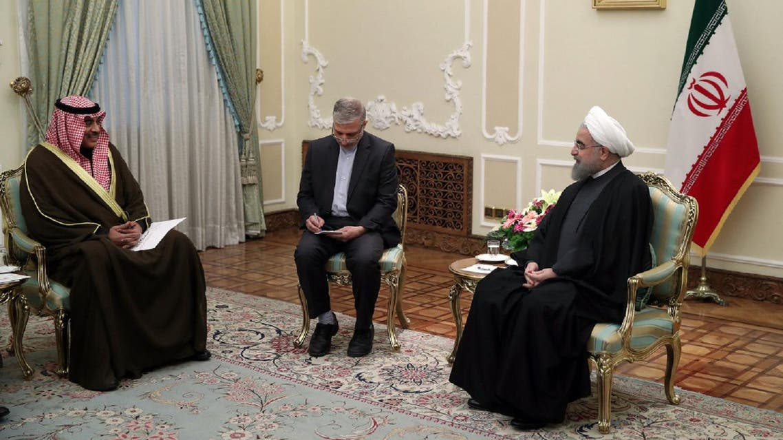 A handout picture provided by the office of Iranian President Hassan Rouhani shows him (R) meeting with Kuwait's Foreign Minister Sabah Al-Khalid Al-Sabah (L) in the capital Tehran, on January 25, 2017. (AFP)