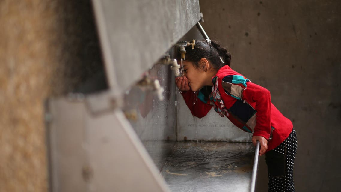 A Palestinian girl drinks water from a public tap in Jabaliya refugee camp in the northern Gaza Strip January 24, 2017. Picture taken January 24, 2017. REUTERS