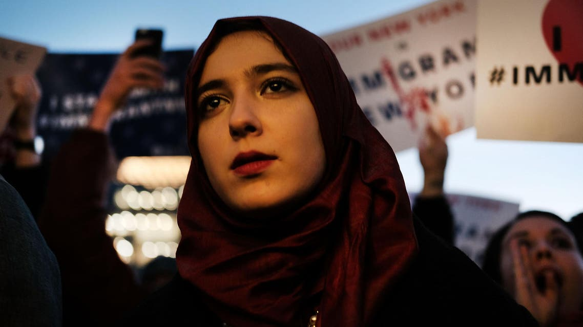 Hundreds of people attend an evening rally at Washington Square Park in support of Muslims, immigrants and against the building of a wall along the Mexican border on January 25, 2017 in New York City. (AFP)