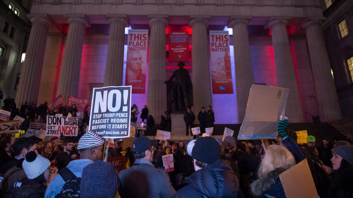 NYC Coalition to Resist Trump holds Inauguration Day protest and march past Federal Hall to the Trump Building on Wall Street, January 20, 2017 in New York. (AFP)