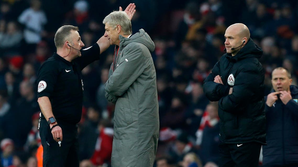 Arsenal's French manager Arsene Wenger (2nd L) is sent to the stands by English referee Jonathan Moss (L) as fourth official Anthony Taylor (R) looks on during the English Premier League football match between Arsenal and Burnley at the Emirates Stadium in London on January 22, 2017. Arsenal won the game 2-1. (AFP)