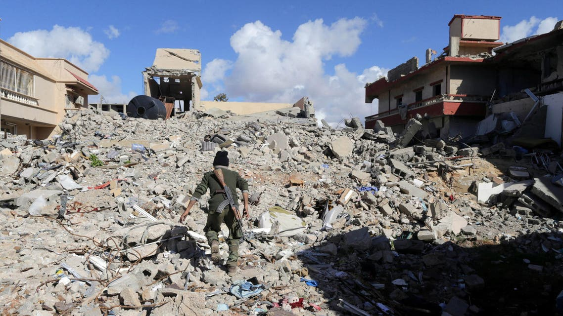 A member of East Libyan forces walks amidst the debris in Ganfouda district in Benghazi, Libya January 26, 2017. reuters