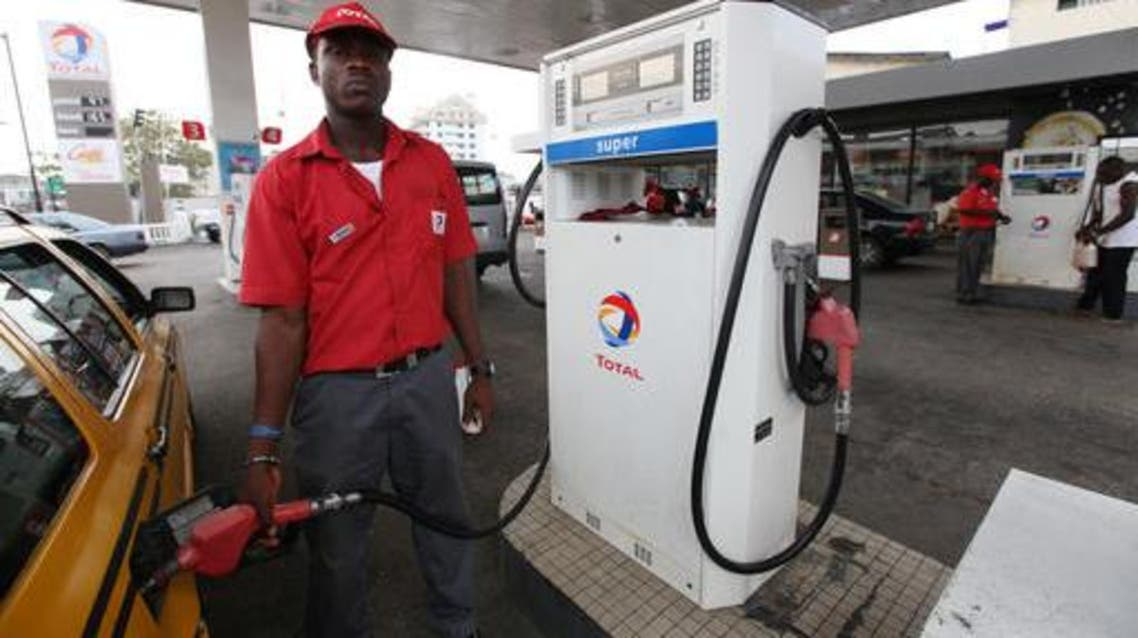 A petrol attendant fills a car at a Total petrol station in Lagos, Nigeria.  (File photo: AP)
