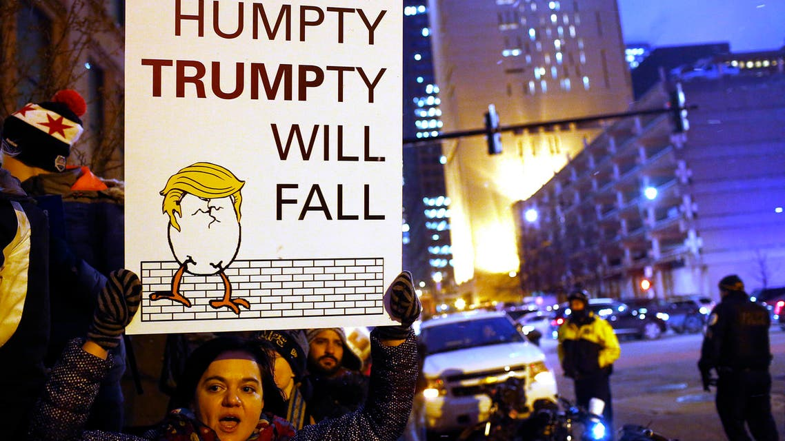 Demonstrators protest President Donald Trump's plan to build a border wall along the United States and Mexico border on January 26, 2017 in Chicago, Illinois. (AFP)