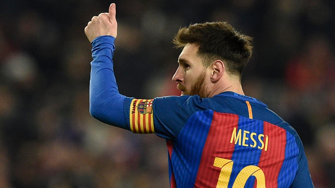 Barcelona's Argentinian forward Lionel Messi celebrates after scoring during the Spanish Copa del Rey (King's Cup) quarter final second leg football match FC Barcelona vs Real Sociedad at the Camp Nou stadium in Barcelona on January 26, 2017. (AFP)