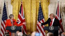 Trump wants good relationship with Russia, May says sanctions should stay
