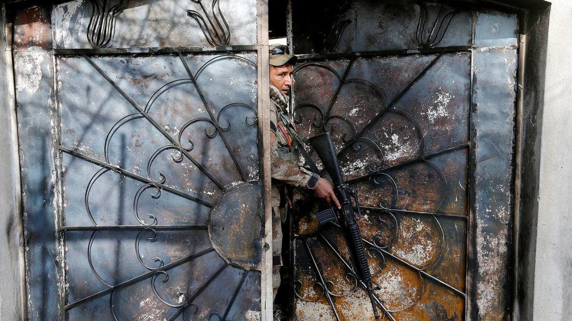 A member of the Iraqi army holds his weapon during an operation to search for weapons in the Arabi neighborhood in Mosul. (Reuters)
