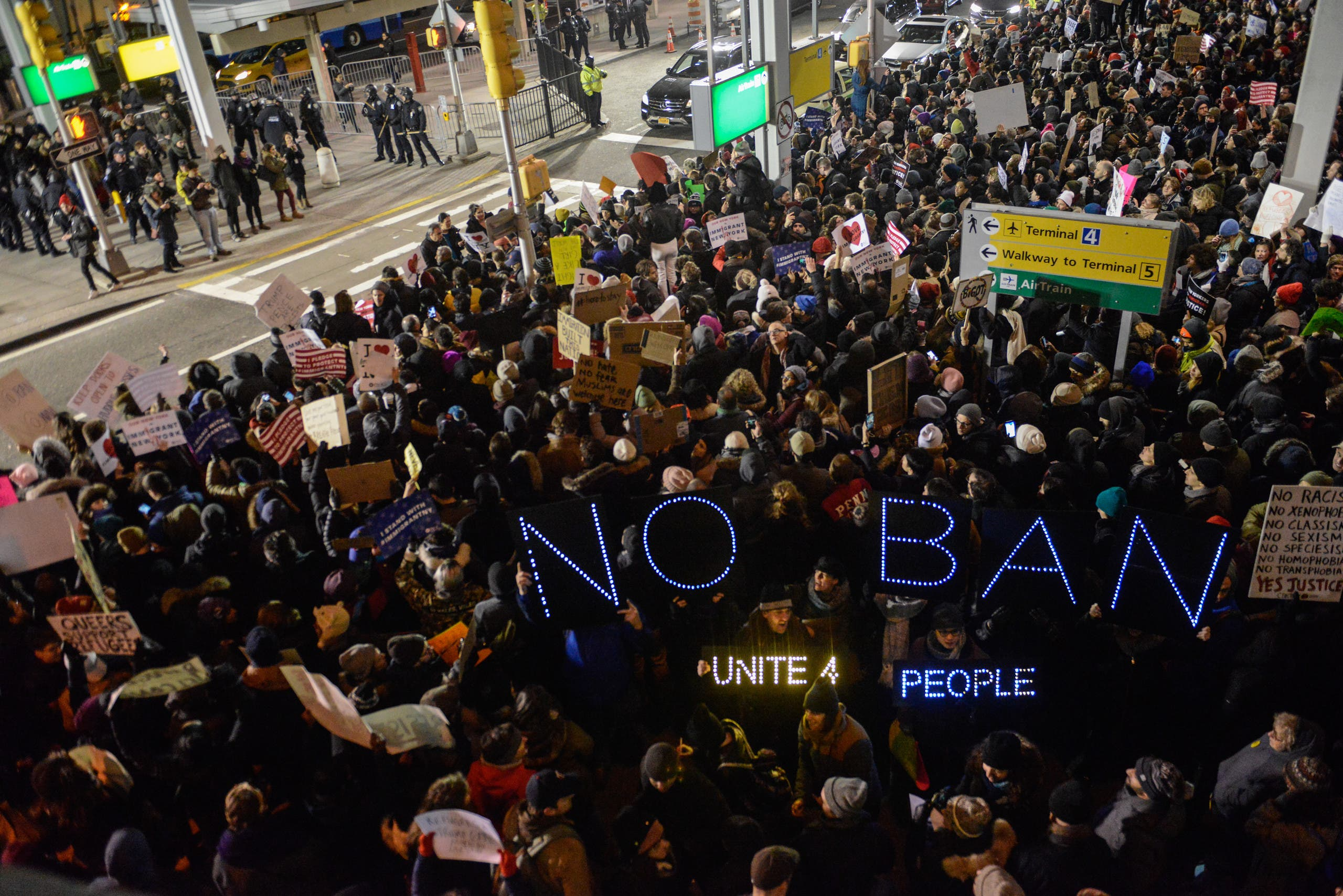 NEW YORK, NY - JANUARY 28: Protestors rally during a demonstration against the Muslim immigration ban at John F. Kennedy International Airport on January 28, 2017 in New York City. President Trump signed the controversial executive order that halted refugees and residents from predominantly Muslim countries from entering the United States. Stephanie Keith/Getty Images/AFP