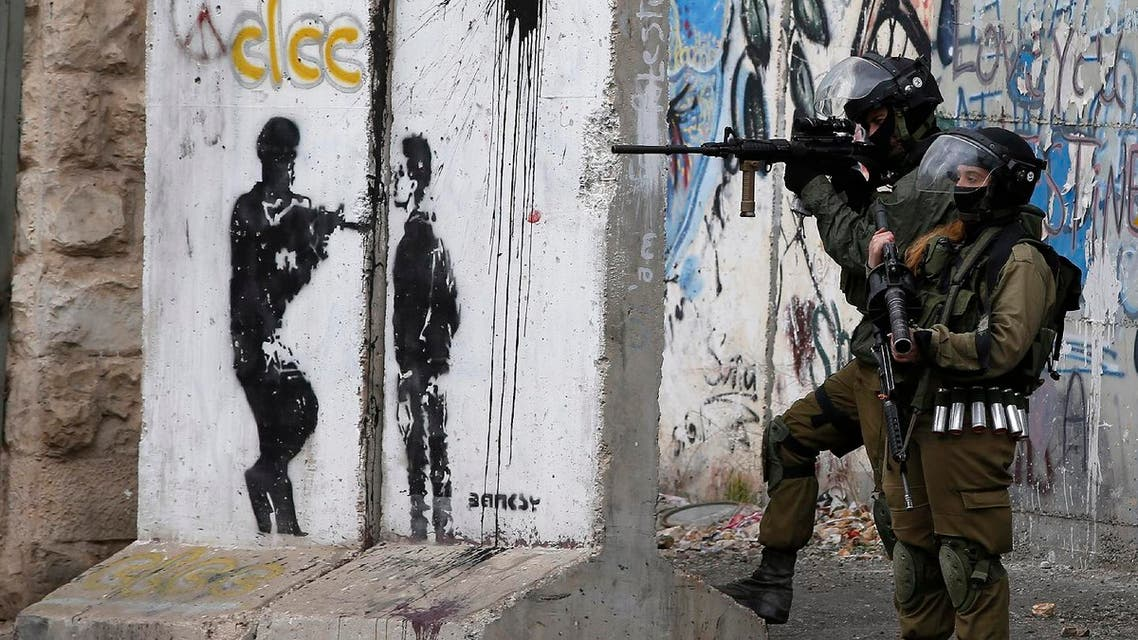 Israeli security force hold a position during clashes with Palestinian stone throwers following a demonstration demanding that Israeli authorities return the bodies of Palestinians killed during attacks on Israel, in the West Bank town of Bethlehem on January 26, 2017.