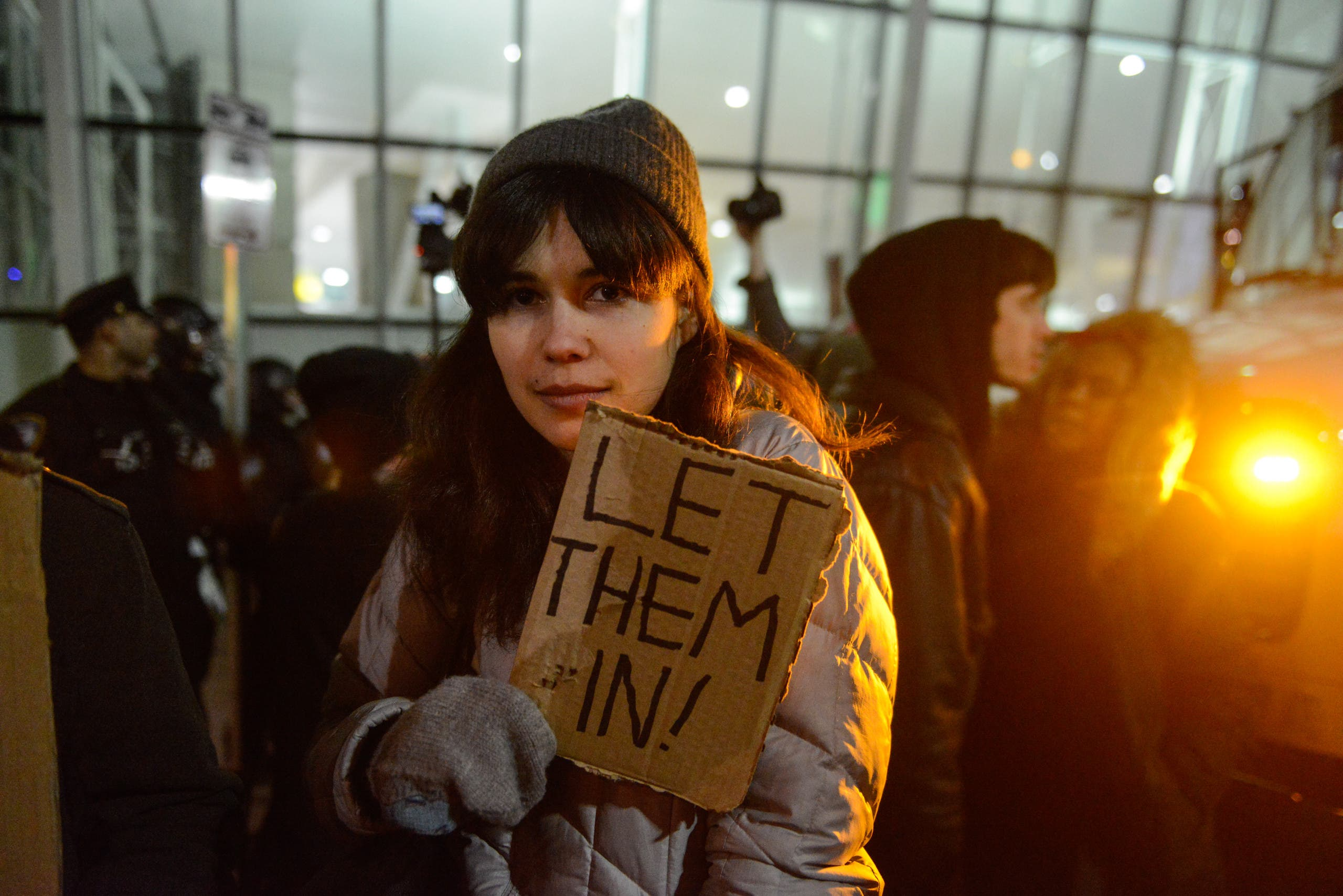 Protestors rally during a demonstration against the new immigration ban issued by President Donald Trump at John F. Kennedy International Airport on January 28, 2017 in New York City