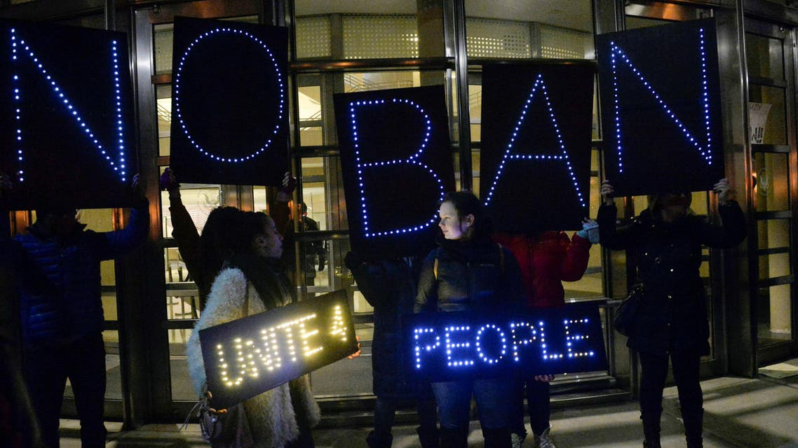 Activists hold placards outside the U.S. Courthouse where a federal judge issued an emergency stay that temporarily blocks the U.S. government from sending people out of the country after they have landed at a U.S. airport with valid visas, in Brooklyn, New York, January 28, 2017. REUTERS/Rashid Umar Abbasi TPX IMAGES OF THE DAY