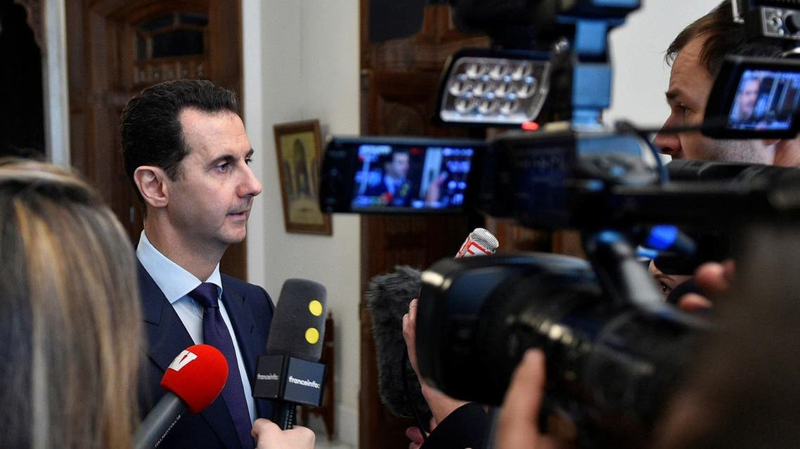 Syria's President Bashar al-Assad speaks to French journalists in Damascus on Jan. 9. (Reuters)