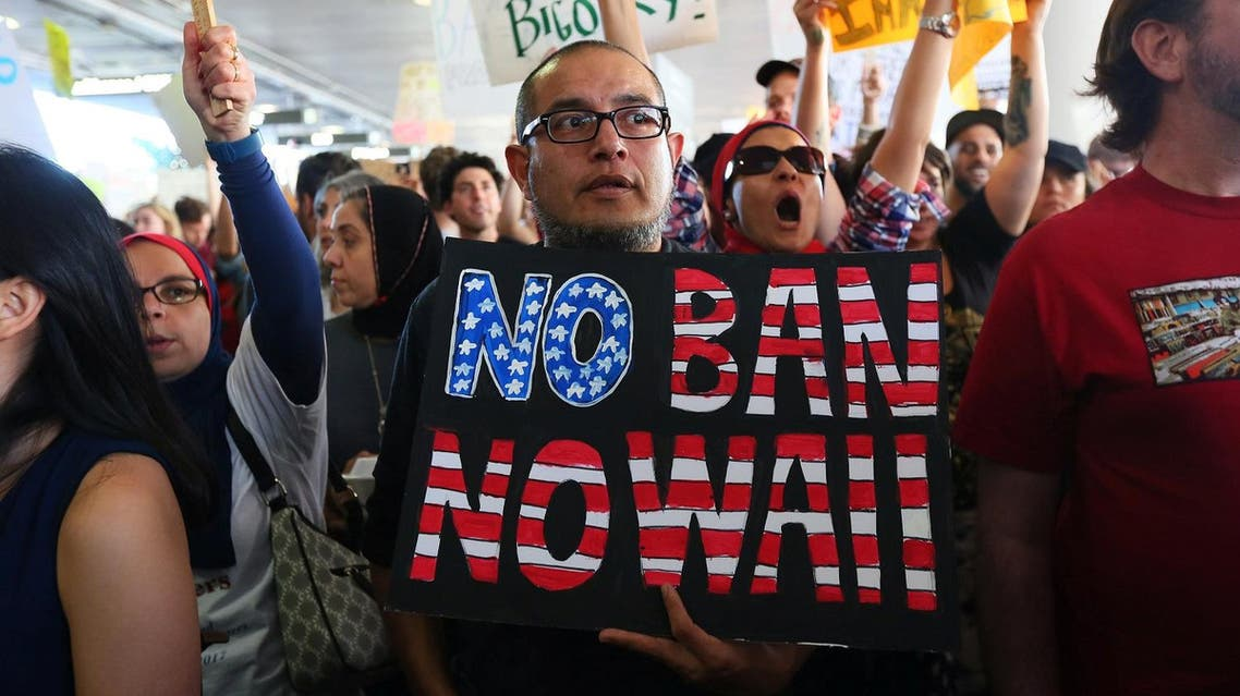 Demonstrators yell slogans during protest against the travel ban imposed by U.S. President Donald Trump's executive order, at Los Angeles International Airport in Los Angeles reuters