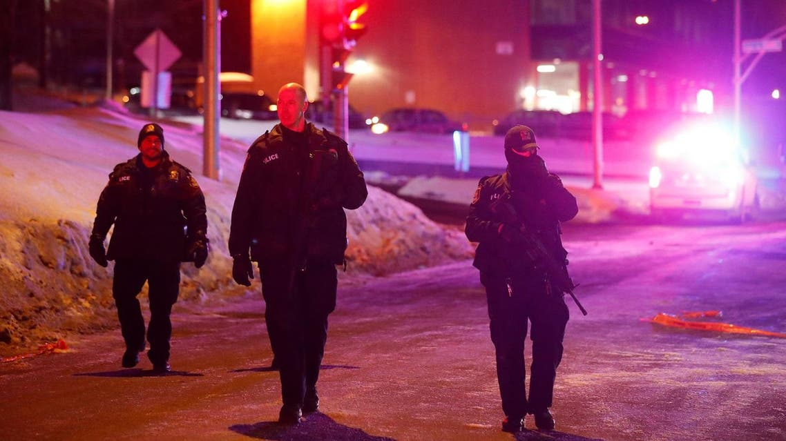 Police officers patrol the perimeter near a mosque after a shooting in Quebec City. (Reuters)