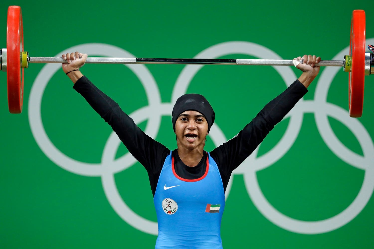Ayesha Shahriyar M. Albalooshi, of the United Arab Emirates, competes in the women's 58kg weightlifting competition at the 2016 Summer Olympics in Rio de Janeiro. (AP)