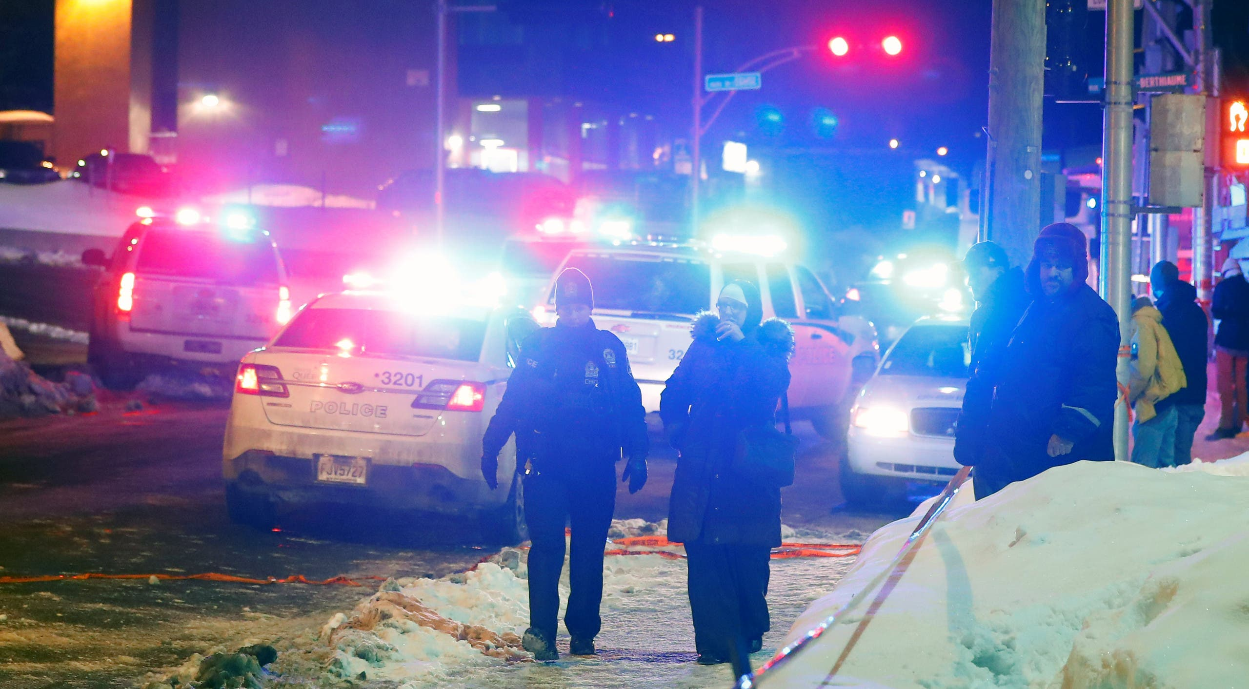 An ambulance is parked at the scene of a fatal shooting at the Quebec Islamic Cultural Centre in Quebec City. (Reuters)