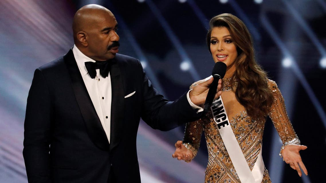 Miss France Iris Mittenaere speaks next to emcee Steve Harvey during the question and answer portion before winning the 65th Miss Universe beauty pageant at the Mall of Asia Arena, in Pasay, Metro Manila, Philippines January 30, 2017. (Reuters)
